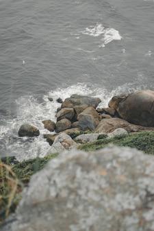 Vertical image of a rocky shore in sao francisco do sul, brazil