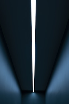 Vertical light in a long blue room