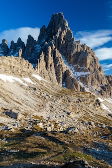 Vertical low angle shot of the paternkofel mountain in the italian alps