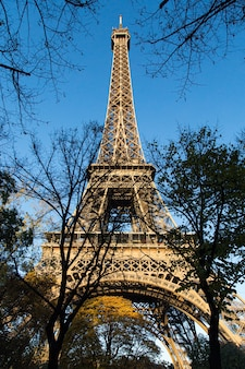Vertical low angle view of the eiffel tower under the sunlight at daytime in paris in france