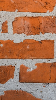 Vertical old brick wall texture background close up.