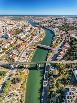 Vertical panorama of the bridges of the city of tavira and the gilao river.