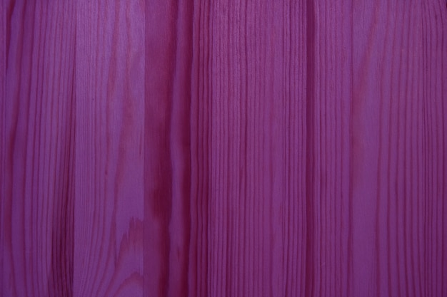 Vertical pattern of deep magenta colored wooden wall surface for background