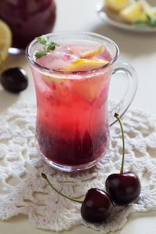 Vertical photo of homemade cherry lemonade in glasses