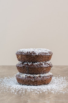 Vertical photo of stack of homemade biscuits on grey.