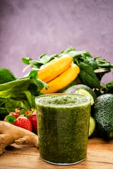 Vertical photo of vegetable and fruit smoothie detox drink for healthy diet