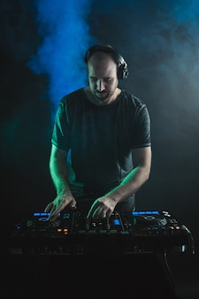 Vertical picture of a male dj working