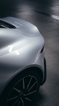 Vertical picture of part of a grey car