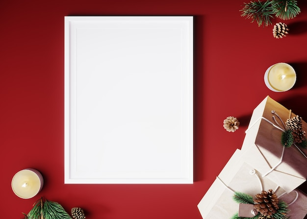 Vertical poster mock up with white frame, decorated christmas tree, candles and gift decoration on red background.