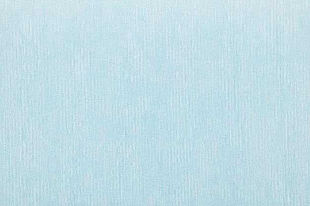 파란색의 추상적 인 배경을위한 비닐 벽지의 수직 거친 질감