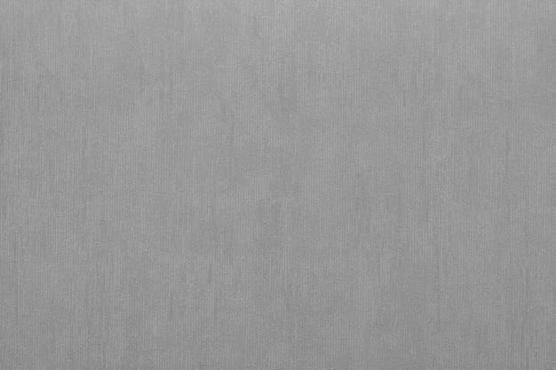 회색의 추상적 인 배경을위한 비닐 벽지의 수직 거친 질감