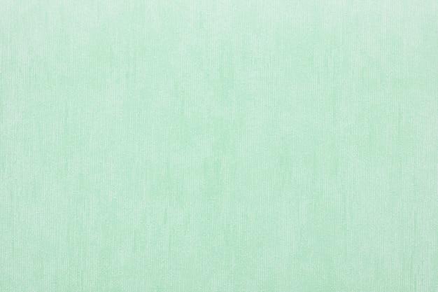 녹색의 추상적 인 배경을위한 비닐 벽지의 수직 거친 질감