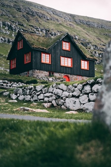 Vertical selective focus shot of faroese wooden house in kirkjubour