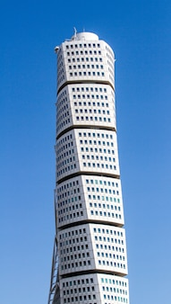 Vertical shot of the ankarparken skyscraper under a blue sky and sunlight