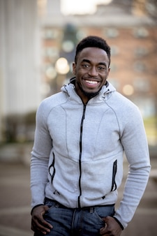 Vertical shot of an attractive african american man posing and smiling