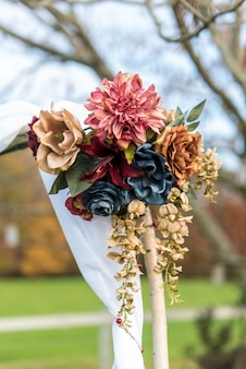 Vertical shot of a beautiful flower bouquet wedding decoration with a blurred background