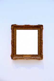 Vertical shot of a bright white sheet framed in a wooden frame