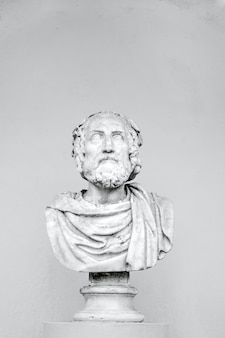 Vertical shot of a bust of a philosopher isolated