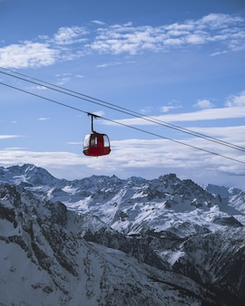 Vertical shot of a cabin of the ropeway over the mountains