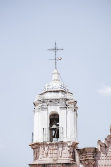 Vertical shot of a church bell tower