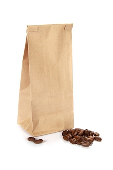 Vertical shot of coffee beans by a paper bag