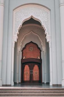 Vertical shot of the doors of the mosque