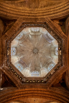 Vertical shot of the inside of the dome inside barcelona's cathedral