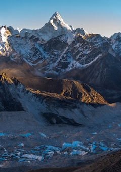 Vertical shot of the khumbu and the ama dablam with a vlue sky in the