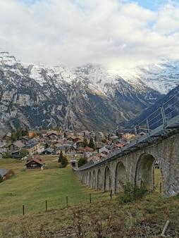 Vertical shot of lauterbrunnen village and the bernese alps in switzerland