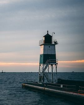 Vertical shot of a lighthouse and a beautiful sunset