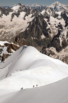 Vertical shot of the magnificent mountain peaks covered with snow