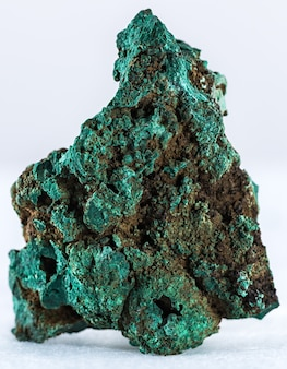 Vertical shot of a malachite mineral isolated on a white background