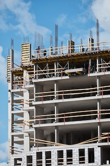 Vertical shot of residential building under construction with brick and concrete structure