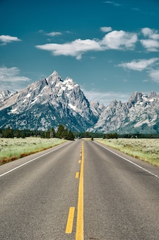 Vertical shot of a road leading to grand teton national park, wyoming usa