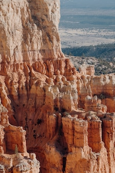 Vertical shot of rock formations in a canyon under the sunlight