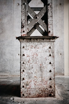 Vertical shot of a rusty metal stand in roubaix, france