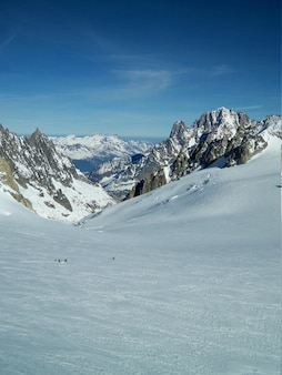 Vertical shot of a snowy scenery surrounded by mountains in mont blanc