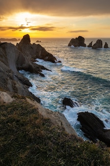 Vertical shot of sunset in the urros de liencres, cantabria, spain
