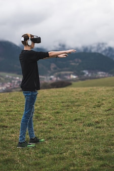 Vertical shot of a teenage male using virtual reality and forgetting