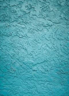 Vertical shot of the textures and patterns of a wall with nice blue paint