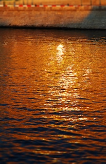 Vertical sunset river surface city background