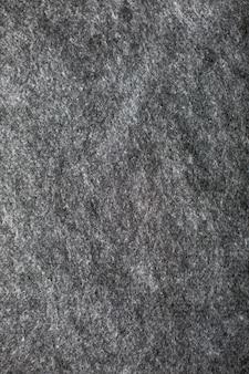 灰色のウール生地の背景の垂直テクスチャ