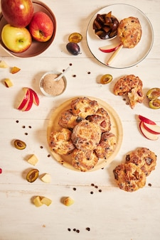 Vertical top view of baked delicious apple curd balls on a table with ingredients