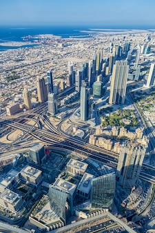 Vertical view of dubai city from the top of a tower.