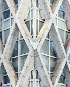 Vertical view of a geometrical white concrete building captured