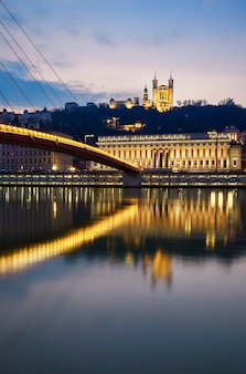 Vertical view of saone river at lyon by night, france