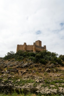 Vertical wide shot of a castle in a hill in north of portugal