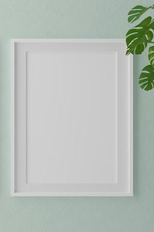 Vertical wooden frame mock up on green wall with plants