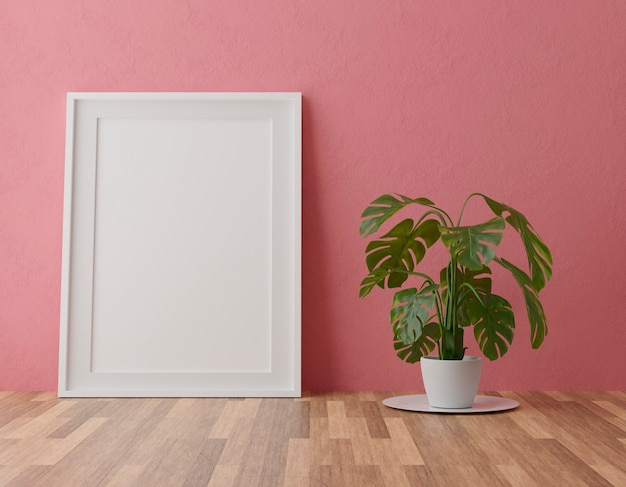 Vertical wooden frame on red wall background with plant