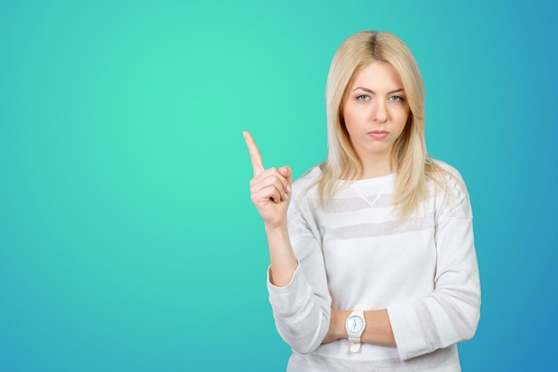 A very annoyed woman point her finger